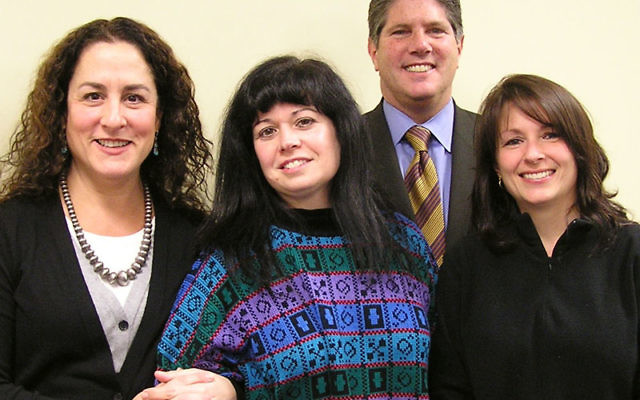 Preparing for Super Sunday, cochairs Judy Bortnick, second left, and Penny Pierce, right, join Emily Josephson, vice president for allocations and community relations, and Mark Merkovitz, campaign vice president.