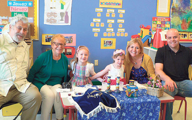 "A ""Shabbat girl"" celebrates with her family at the Early Childhood Center of Congregation Agudath Israel in Caldwell, which is adding a class for toddlers this fall."