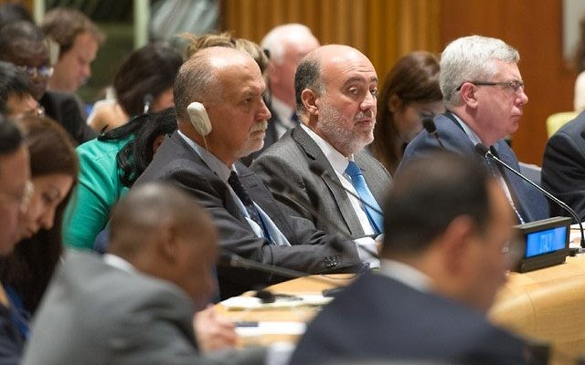 Ambassador Ron Prosor, center, without headphones, speaks at the U.N. General Assembly. UN Photo by Mark Garten