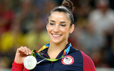 Aly Raisman celebrates on the podium after winning a silver medal in the floor exercise at the Rio Olympic Arena, Aug. 16.