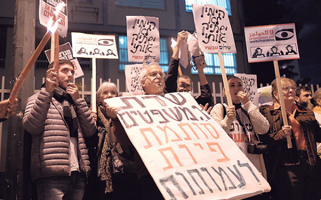 Activists protesting a proposed law governing NGO financial disclosure outside the Tel Aviv home of Israeli Justice Minister Ayelet Shaked, Dec. 26, 2015.