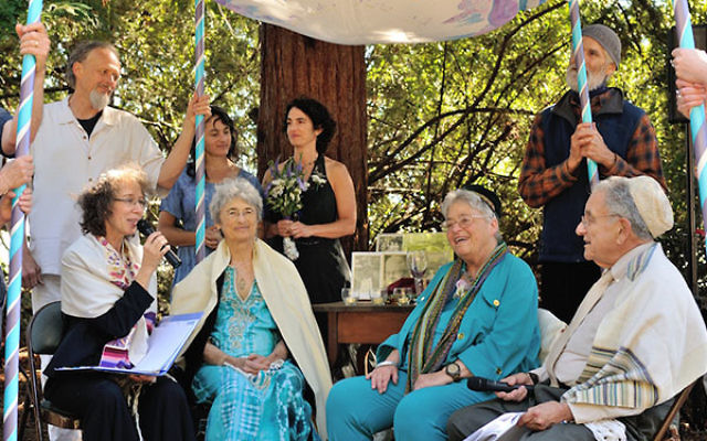 At 76, longtime activists Shoshana Dembitz, seated, center left, and Abigail Grafton, seated, center right, married in El Cerrito, Calif., on June 27. The ceremony was officiated by Rabbi Diane Elliot, seated left, and her husband, Rabbi Burt Jacobson. (L