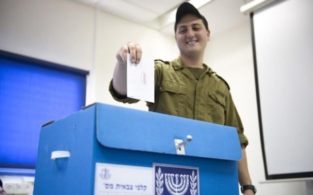 AnIsraeli soldier taking part in early voting, March 15, 2015. (IDF Spokesperson)