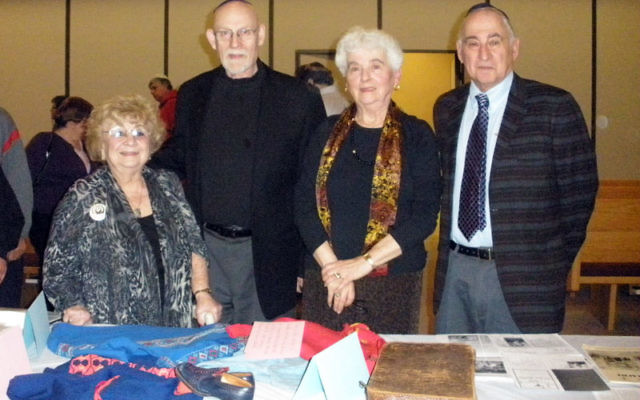 With Rabbi Eugene Wernick, second from left, three survivors — from left, Vera Nussenbaum and Ruth and Dr. Eugene Gottlieb — commemorate Kristillnacht at Congregation Beth Ohr in Old Bridge on Nov. 9. The display of items includes the dress
