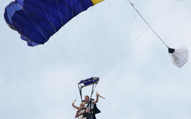 Aaron Rosloff — front, with an instructor — went skydiving on July 3 to celebrate his 90th birthday and raise money for the Food Pantry of South Brunswick. Photo by Ben Gottesman