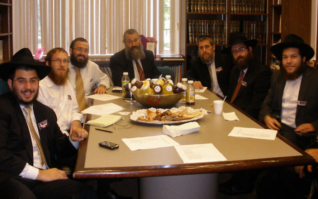 Rabbis gather at Chabad House at Rutgers University in New Brunswick for the July 12 inaugural meeting of a statewide organization for Chabad chaplains. Photo by Debra Rubin