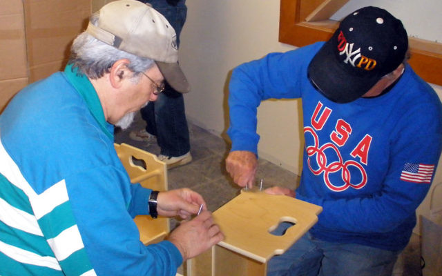 """Peter Schild of Old Bridge and Allan Greenberg of Highland Park joined other members of the Highland Park Conservative Temple-Congregation Anshe Emeth at an """"assembly party"""" Jan. 24 to put together furniture and equipment for its Above and Bey"""
