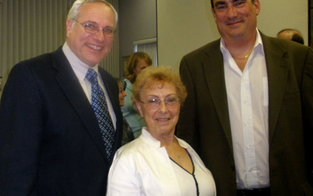 Robert Bielsky, right, whose father was one of the famous Bielski brothers, spoke May 23 at Congregation Etz Chaim Monroe Township Jewish Center. With him is Rabbi Benjamin Levy and Harriet Katz. Photos by Debra Rubin