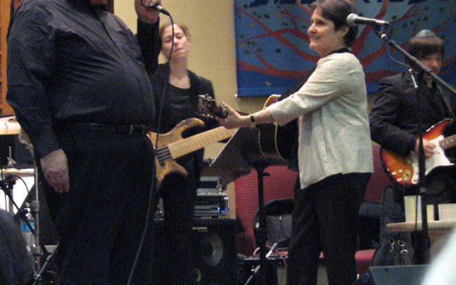 Debbie Friedman is joined by Cantor Bruce Rockman at a concert at Congregation B'nai Tikvah in North Brunswick in 2009. Photo by Bobbi Binder