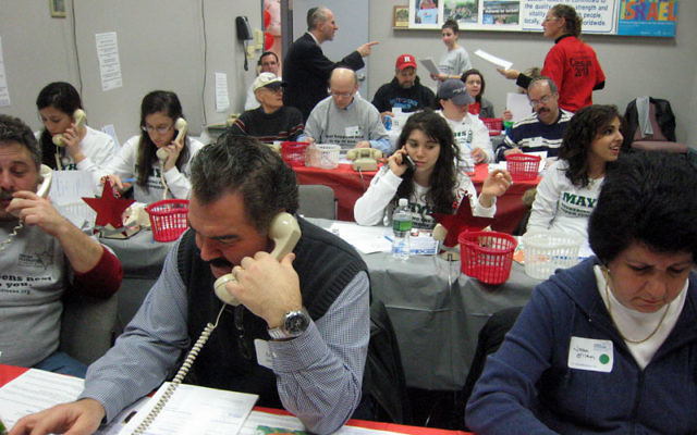 Volunteers make phone calls at last year's Super Sunday phonathon of the Jewish Federation of Greater Middlesex County. Photo courtesy Jewish Federation of Greater Middlesex County