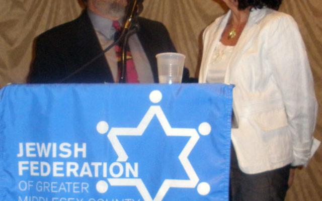 New federation president Arlene Frumkin is congratulated by her rabbi, Robert Wolkoff, of Congregation B'nai Tikvah. Photos by Debra Rubin