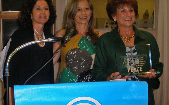 Susan Mandell, right, receives the Kipnis-Wilson/Friedland Award-National Women's Philanthropy during the Middlesex federation's annual meeting, as federation president Arlene Frumkin, left, and vice president Sandy Lenger look on. Photo by De