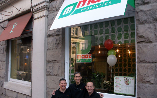Maoz co-owners, from left, David Brous, Robert Wolberg, and Larry Goldberg, celebrate the restaurant's opening in New Brunswick.