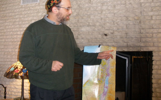 Rabbi Michael Cohen of the Arava Institute for Environmental Studies on Kibbutz Ketura, explains the environmental problems threatening Israelis and Palestinians during a program in Highland Park sponsored by Central New Jersey J Street. Photo by Debra