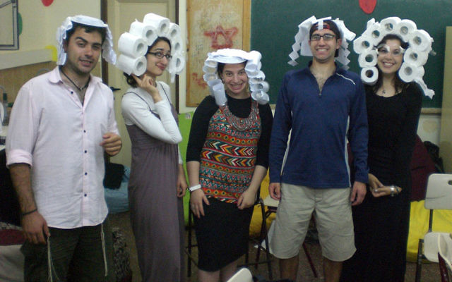 On a roll: Avital Chizhik, far right, joins other counselors to entertain campers at the YU Counterpoint Israel program in Arad.