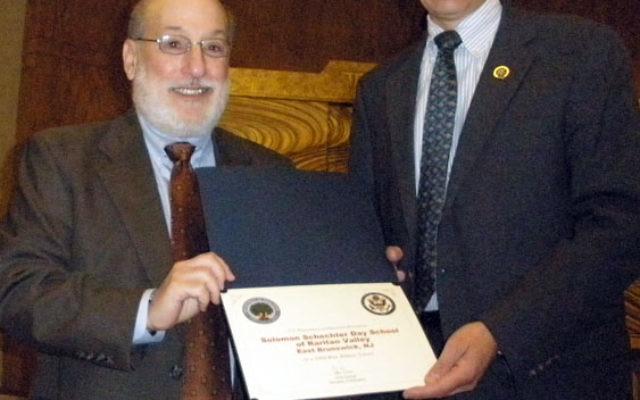 Rep. Rush Holt, right, presents a congratulatory proclamation to head-of-school Dr. Howard Rosenblatt on Solomon Schechter Day School of Raritan Valley's designation as a Blue Ribbon School.