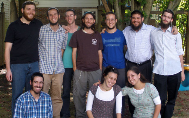 The Steinsaltz Ambassadors gather Aug. 27 in the Highland Park backyard of program director Rabbi Shmuel Greene, standing, second from right, before being sent to do service in Jewish institutions in New Jersey, Washington, and Arizona. Binyamin Zuckerm