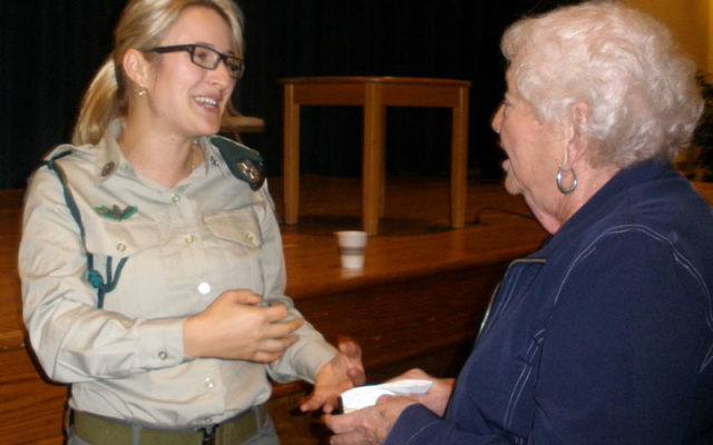 Miri Levy — one of the first three women to go undercover as part of the Israeli border police — greets a community member after her Sept. 26 talk at Temple B'nai Shalom in East Brunswick.