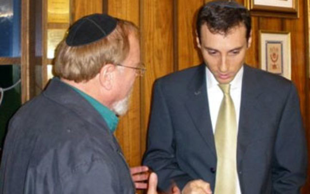 Uriel Heilman, right, managing editor of the Jewish Telegraphic Agency, speaks to a congregant at Temple Beth El of Somerset after delivering the annual Dr. Michael Fink Memorial Lecture.