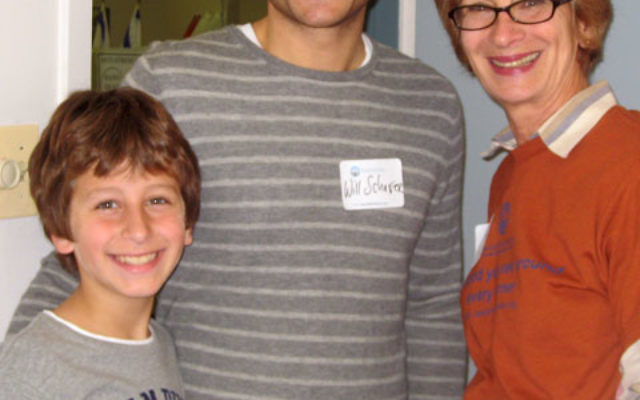 Matthew Schafer of East Brunswick — with his father, federation board member Will Schafer, and allocations cochair Diane of Hoffman of Highland Park — made his first pledge to federation at Super Sunday. Photos courtesy Jewish Federation of