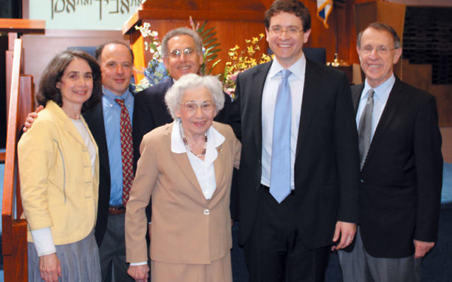 Commemorating the 25th anniversary of the Israel Segal Memorial Lecture at Neve Shalom in Metuchen are, his widow, Shirley, front, and from left, children Deena Segal Fraint, Danny Segal, and Eric Segal; speaker Dr. Julian Zelizer; and Rabbi Gerald Zeli