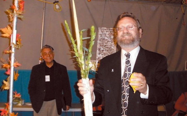 "Rabbi Robert Wolkoff — shown at an interfaith Sukkot celebration last October at Congregation B'nai Tikvah — said Jews should be ready to fight ""for the right of our neighbors to observe their holidays."" Photo by Debra Rubi"