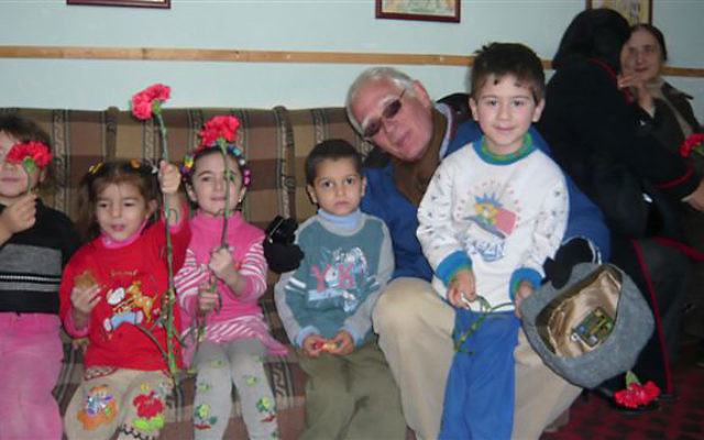 Lee Livingston visits with children at the JCC in Bukhara.