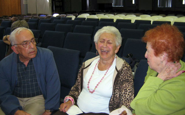 Former Weequahic High School English teacher Hilda Lutzke, center, exchanges fond remembrances with former Newark residents following the Sept. 13 meeting of the Jewish Historical Society of Central Jersey at Congregation Etz Chaim Monroe Township Jewis