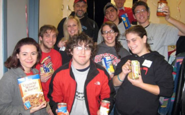 Students and staff from Rutgers Hillel, a beneficiary of Jewish Federation of Greater Middlesex County, arriving at Super Sunday to make phone calls, accompanied by Hillel executive director Andrew Getraer, rear left, and Rabbi Yisroel Porath, rear right,