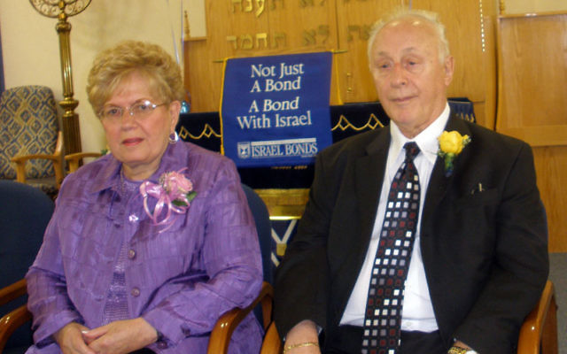 Jack Chevlin of Monroe, a former music teacher at Roselle Park High School, had his life saved by a partisan who led his family and 200 other Jews to safety. He is shown with his wife, Ethel, at an Israel Bonds luncheon at the Jewish Congregation of Con