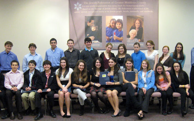 Teen philanthropists on the J. Team of the Jewish Federation of Greater Middlesex County gather at the federation's South River office. The teens awarded $7,000 to four charitable organizations after months of presentations and research. Photo cou