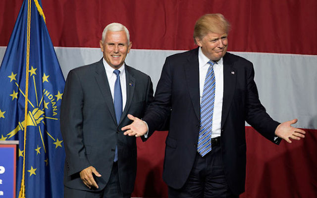 Donald Trump and Indiana Governor Mike Pence onstage during a campaign rally at Grant Park Event Center in Westfield, Indiana, July 12, 2016.