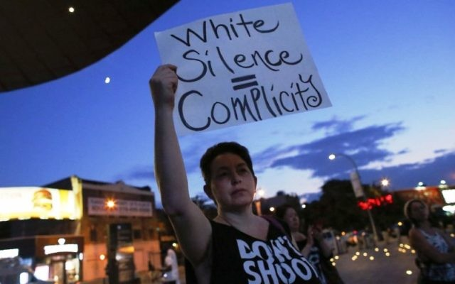 A woman holding a sign at a Brooklyn, N.Y., vigil for victims of the Emanuel AME Church shooting in Charleston, S.C., June 21, 2015. (Kena Betancur/Getty Images)