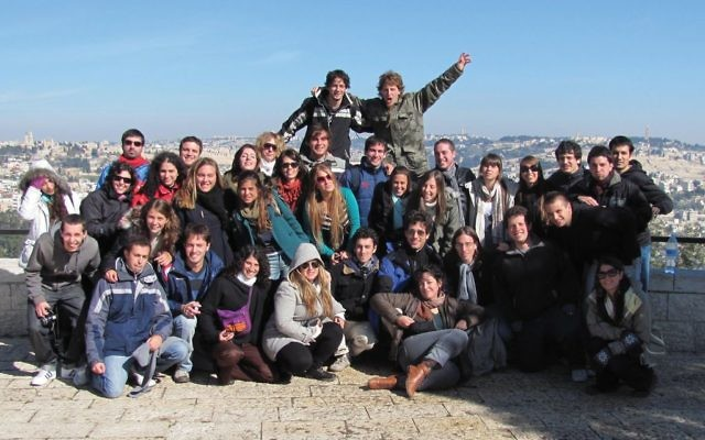 A group of Birthright participants pose during their trip to Israel. Wikimedia Commons