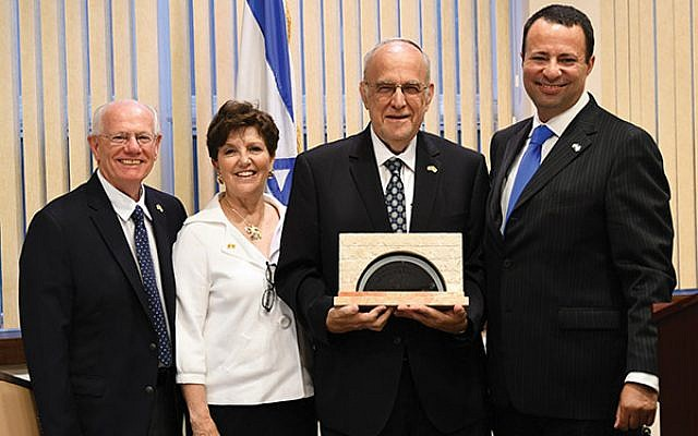 Gordon Haas, second from right, displays his Recognition Award as immediate past president of the State Association; with him are, from left, executive director Jacob Toporek and president Marlene Herman, and Dov Ben-Shimon, executive vice president/CEO, Jewish Federation of Greater MetroWest NJ.