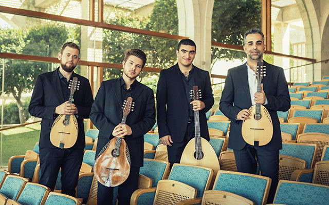 Jacob Reuven, right, and the Be'er Sheva Mandolin Quartet will be performing its program of classical, Israeli folk, and American melodies at the Monroe Senior Center on July 31. Others shown, from left, are Roi Dayan, Deniss Garejevf, and Dor Amran.