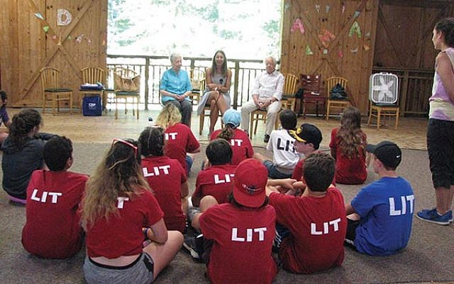 Hanna Keselman and Mark Schonwetter shared their stories of surviving the Holocaust with 14- and 15-year olds at JCC Camp Deeny Riback in Flanders. Schonwetter's daughter, Isabella Fiske (center), moderated. Photos by Johanna Ginsberg