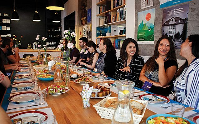 Members of the San Francisco Jewish Community Federation share a meal with Warsaw Jewish community leaders during a young leadership tour to Poland in June.  (Courtesy Taube Jewish Heritage Tours)