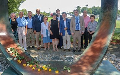 From left, Jennifer DeMaio, Ed Mosberg, Ed Adams, Mayor Michael Soriano, Olga Menczer, Cantor Lois Kittner, Rabbi Moshe Rudin, Swedish Consul General Leif Pagrotsky, Rabbi Andrew Sklarz, and Joe and Magda Ungerleider.