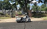 A police motorcycle outside the B'nai Abraham Cemetery in Newark, N.J. (Dov Ben-Shimon/Facebook)