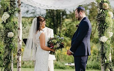 Rebecca and Adam under the chuppah.  Photo by Beet and Blossom