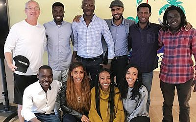 Joey Low (top row, at left), founder of Israel At Heart, with Ethiopian Jews and African asylum seekers on a trip to New York he sponsored this month. Photo Courtesy Joey Low