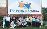 Board members, supporters, and staff celebrate the new name — The Hebrew Academy — of what was the Solomon Schechter Day School of Greater Monmouth County. Photo courtesy The Hebrew Academy