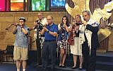 Members of the shofar-blowing team include, from left, Paul Nadler, Marc Rappaport, Charles Silerman, Anastasia Rappaport, Sandy Wilson, and Alan Grossman. Not pictured are Barak Malkin, Rose Lamorte, and Rick Simon. Photo courtesy Sandy Gonzalez Wilson