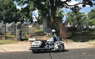 A police motorcycle outside the B'nai Abraham cemetery on Sunday. Courtesy Federation