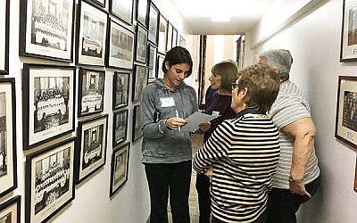Avery Schwab, left, consults with Lyn Tull and Diana Apter at the confirmation wall. Photos by Johanna Ginsberg