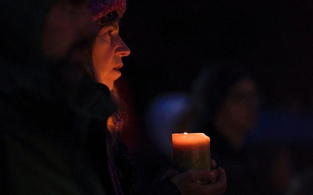 A woman holds a candle during a vigil in Squirrel Hill, Pennsylvania on October 27, 2018, to remember those that died in the Tree of Life Synagogue shooting earlier in the day. Getty Images