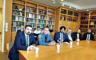 State Attorney General Gurbir Grewal, third from left, with, from left, Jared Maples, Col. Patrick Callahan, Rabbi Yosef Carlebach, Rabbi Moshe Indig, and Rabbi Mendy Carlebach. Photo by Debra Rubin