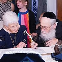 Paula Gottesman with scribe Rabbi Moshe Klein. Photos courtesy Friendship Circle