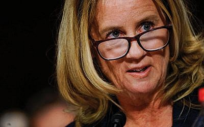 Dr. Christine Blasey Ford answers questions at a Senate Judiciary Committee hearing on Sept. 27. Melina Mara-Pool/Getty Images